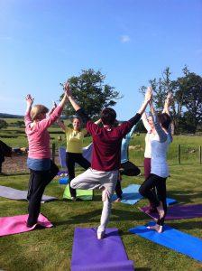 yoga retreat outdoors health sunshine