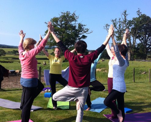 yoga retreat outdoors health sunshine