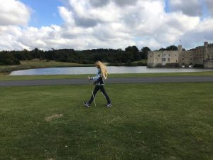 Nordic walking grass outdoors nature health wellbeing
